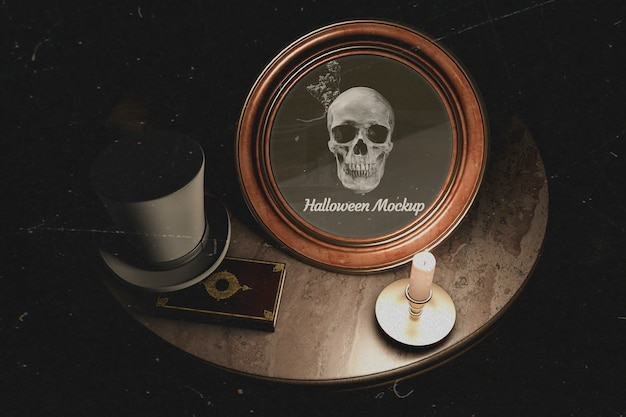 Dark table design of halloween round frame with skull Free Psd