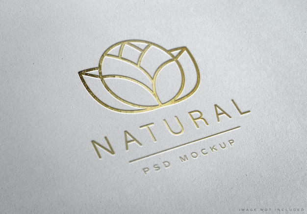 Debossed gold logo  on white paper texture