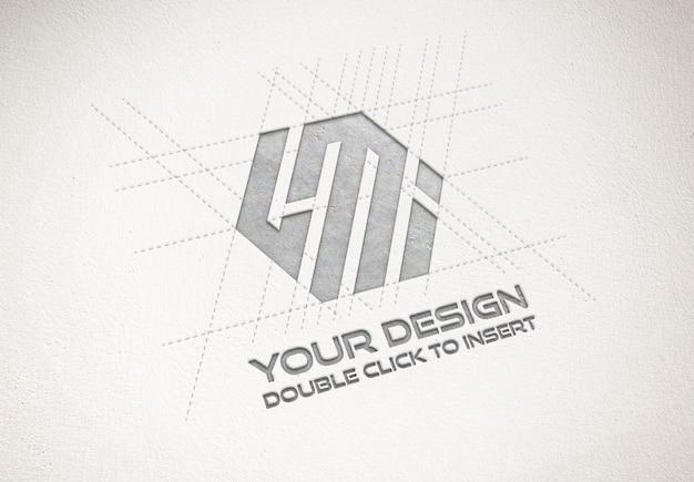 Дебоссированный металлический логотип на текстуре бумаги макет Premium Psd