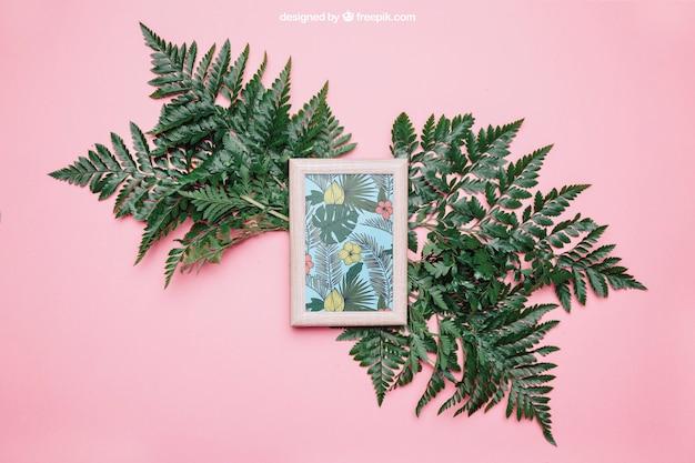 Decorative botanical mockup with frame and big leaves Free Psd