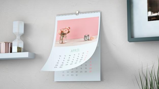 Декоративный календарь макет висит на стене Premium Psd