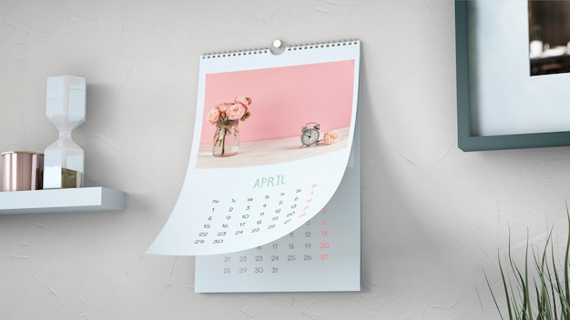 Decorative calendar mockup hanging on wall Free Psd