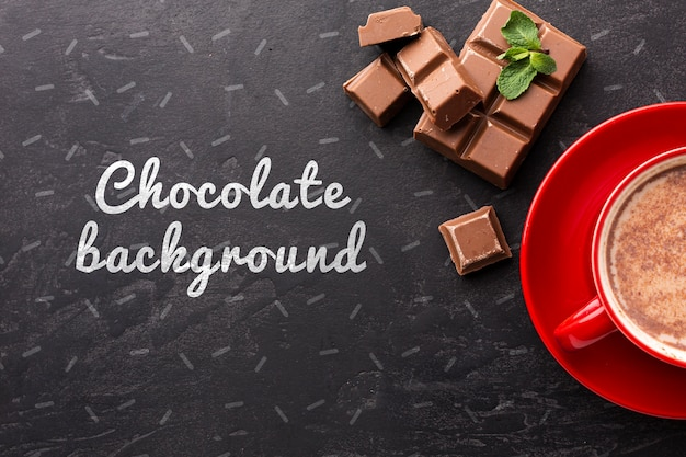 Delicious chocolate bar with black background mock-up Free Psd