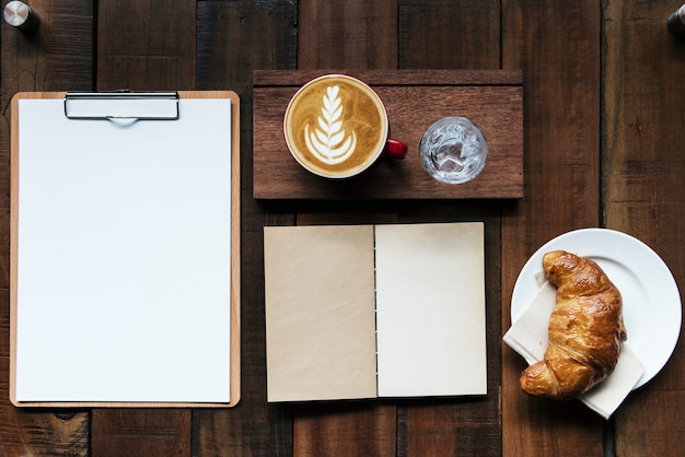 Design space on notepad in the coffee shop Premium Psd