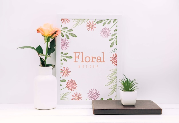 Desk composition with flower decor and frame mockup Free Psd