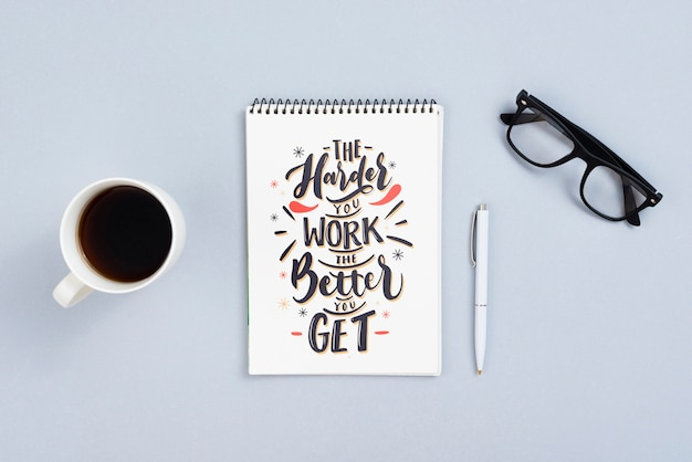 Desk concept with quotation on notebook Free Psd