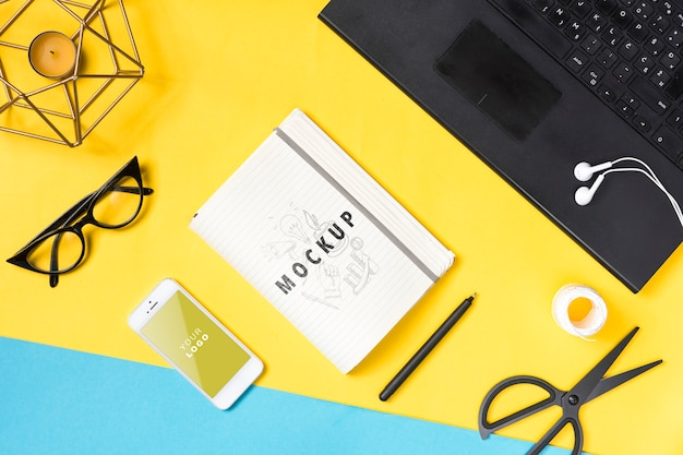 Desk with laptop and notebook Free Psd