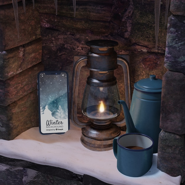 Device and hot tea on kettle on fireplace Free Psd