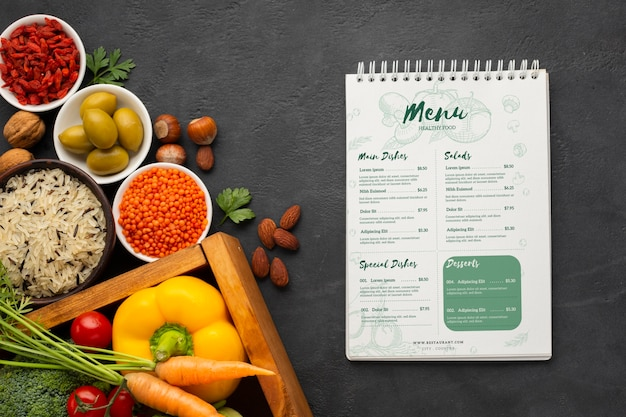 Diet menu idea with veggies in a basket and spices Free Psd
