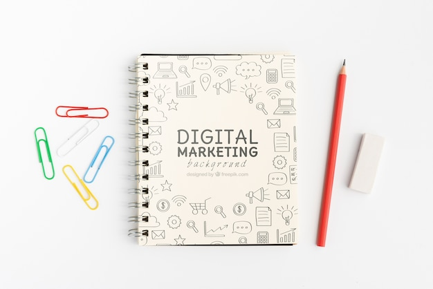 Digital marketing doodle notepad with pencils top view Free Psd
