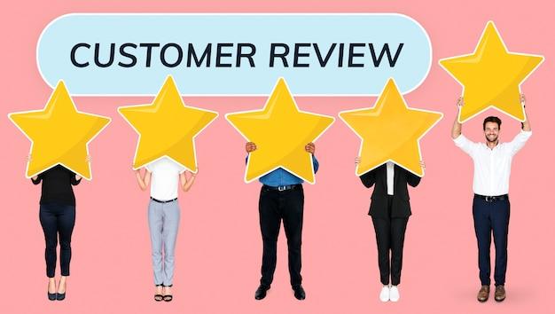 Diverse businesspeople showing golden star rating symbols Premium Psd