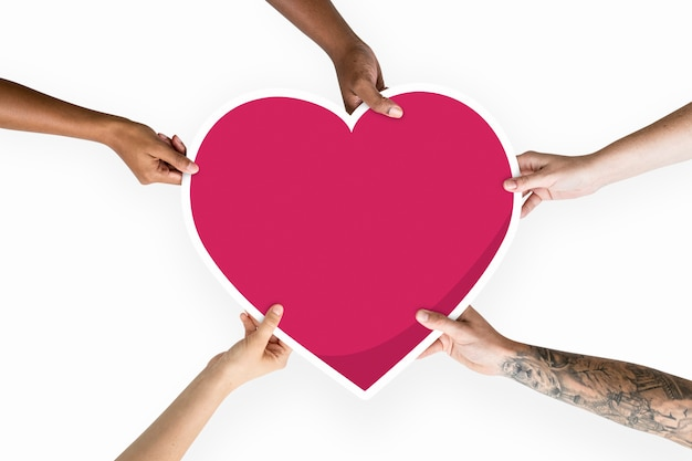 Diverse hands holding a red heart Premium Psd