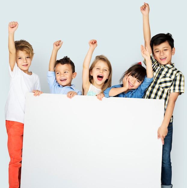 Diversity children showing banner board Premium Psd