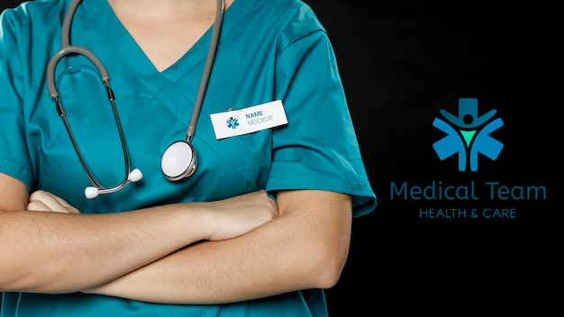 Doctor with stethoscope and labour day badge Free Psd
