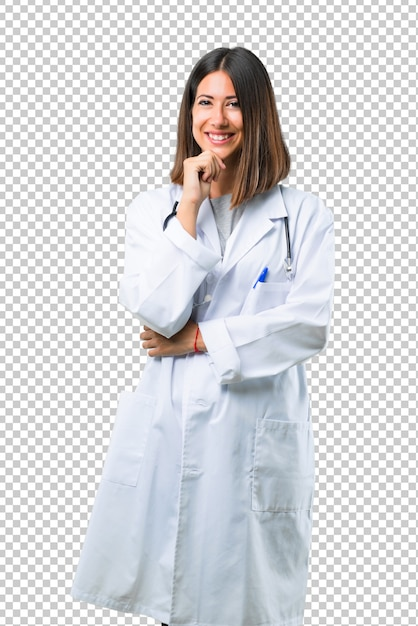Doctor woman with stethoscope smiling and looking to the front with confident face Premium Psd