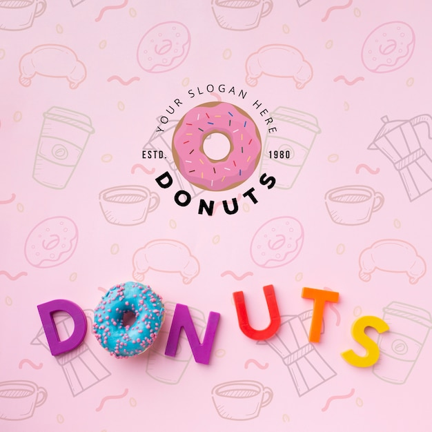 Donut and letters arrangement with mock-up Free Psd