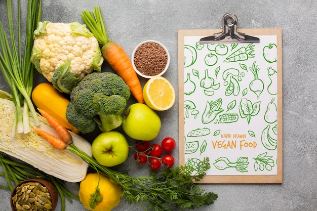 Doodle menu and veggies top view Free Psd