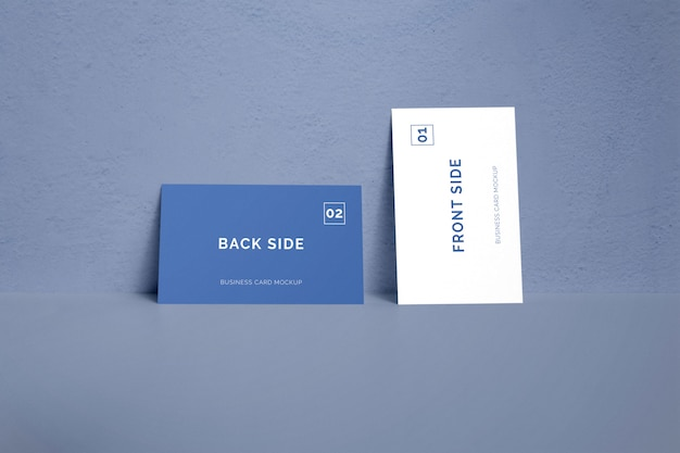 Double sided business card laying on a wall mockup Premium Psd