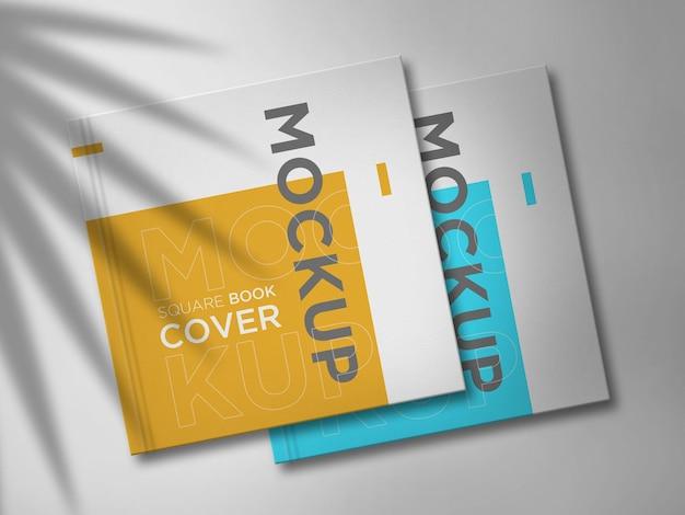 エレガントな影の二重正方形の本のモックアップ Premium Psd