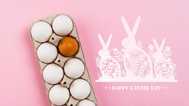 Mockup di giorno di pasqua con uova e coniglietti Psd Gratuite