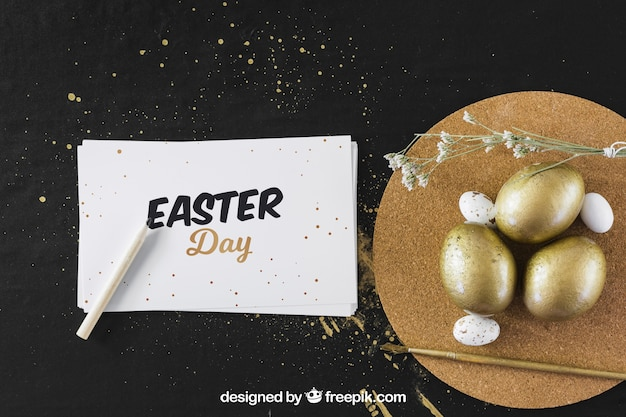 Easter mockup with golden eggs and card Free Psd