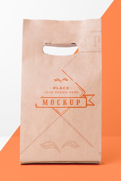 Eco friendly paper bag mock-up on bicolor background Free Psd