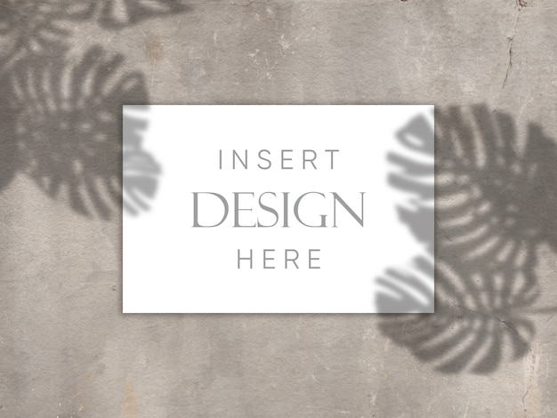 Editable mock up design with blank card on concrete texture with shadow overlay background Free Psd