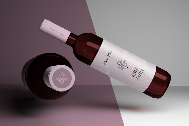 Editable mockup with two wine bottles and blank labels Premium Psd