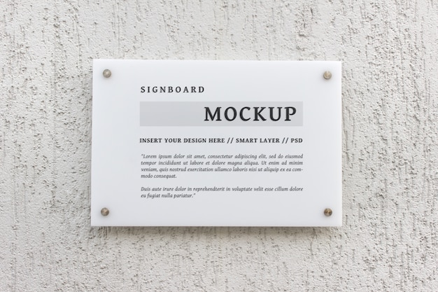 Editable stationery psd mockup of white glass signboard Premium Psd