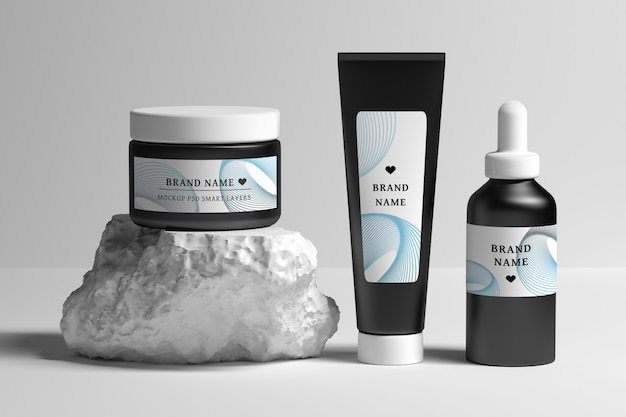 Editable stationery psd mockup with collection of beauty treatment products Premium Psd