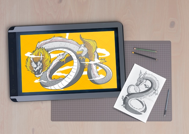 Electronic tablet device with snake draw Free Psd
