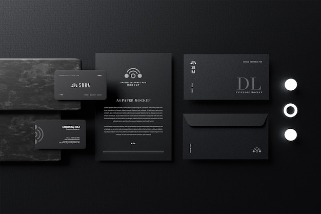 Elegant business card with paper and dl envelope mockup Premium Psd