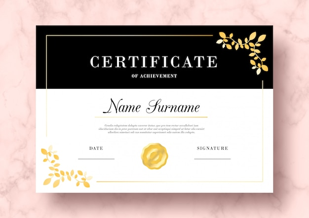 Elegant certificate of achievement with golden leaves psd template Free Psd
