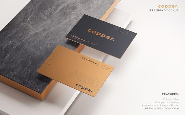 Elegant dark and copper business card psd mockup Free Psd