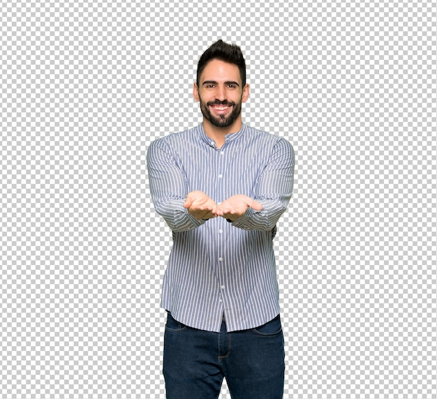 Elegant man with shirt holding copyspace imaginary on the palm to insert an ad Premium Psd