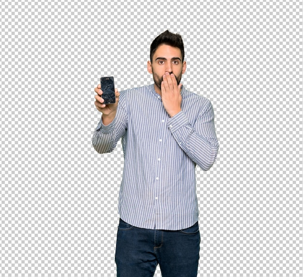 Elegant man with shirt with troubled holding broken smartphone Premium Psd