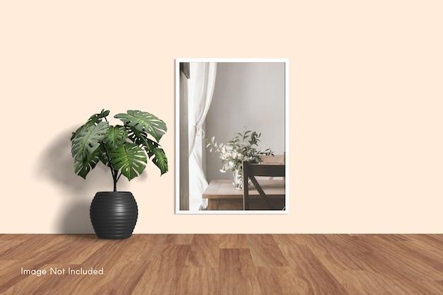 Elegant minimal photo frame mockup hanging on wall Premium Psd