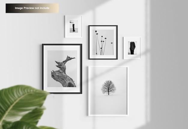 Elegant minimal photo frames mockup hanging on wall Premium Psd