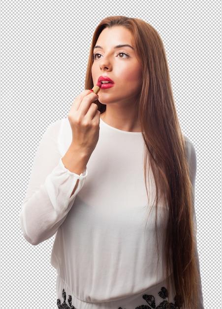 Elegant woman using a lipstick Premium Psd