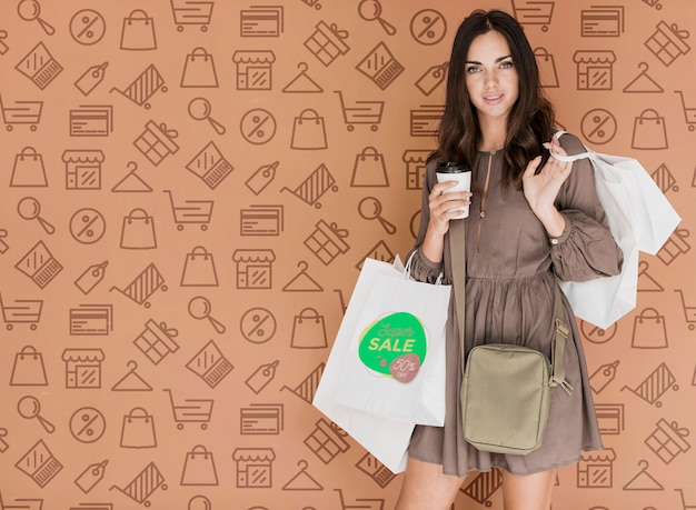 Elegant woman with shopping bags Free Psd