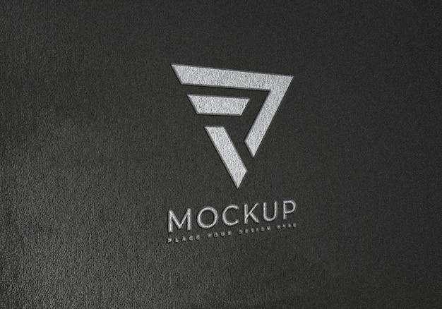 Тиснение макета логотипа на черной текстурной поверхности Premium Psd
