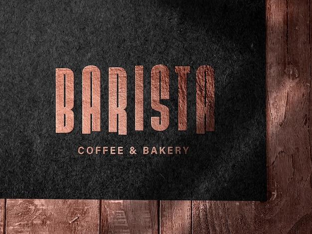 Embossed bronze logo mockup on dark paper Free Psd
