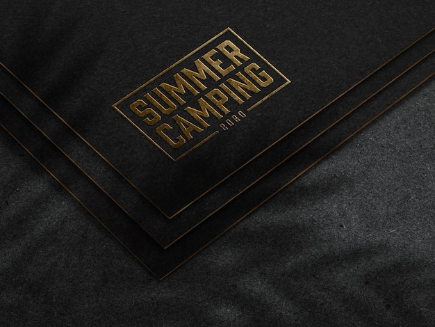 Embossed gold logo mockup on dark paper Free Psd