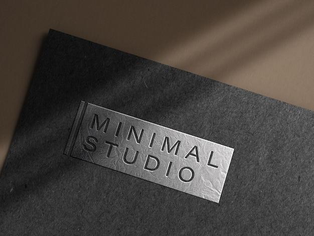 Embossed silver logo mockup on dark paper Free Psd
