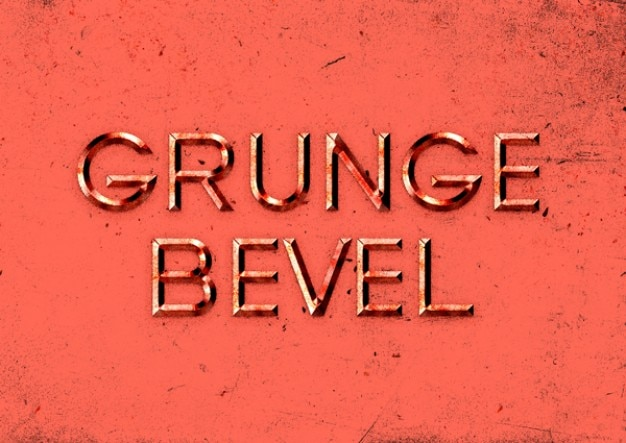 Embossed text effect with grunge style Free Psd
