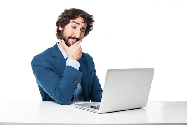 Employee touching his chin while thinking Free Psd