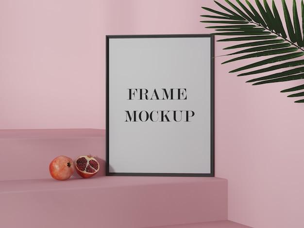 Empty picture frame mockup beside pomegranate Premium Psd