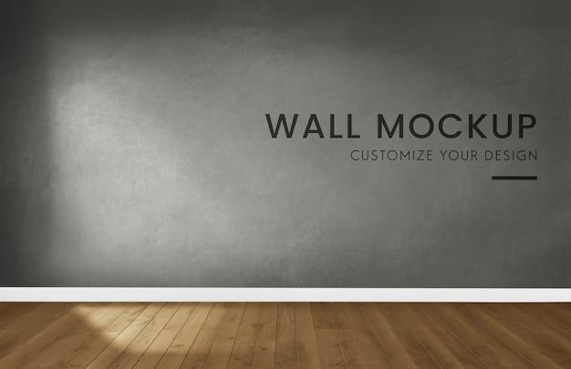 Empty room with a dark gray wall mockup Free Psd