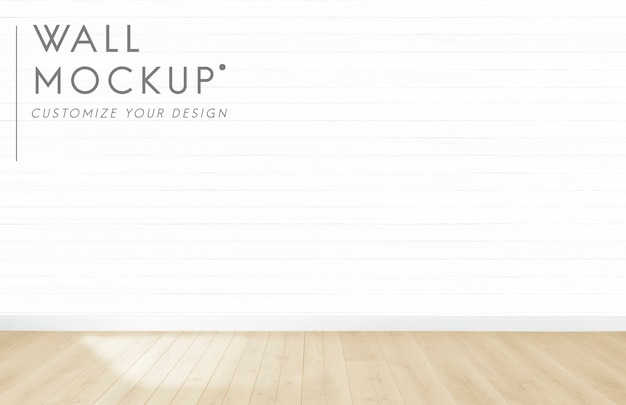 Empty room with a white wall mockup Free Psd