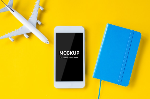 Empty screen smartphone, decorative airplane and notebook, template for app presentation. Premium Psd